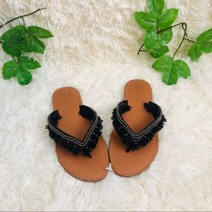 a new day black fringe flip flops